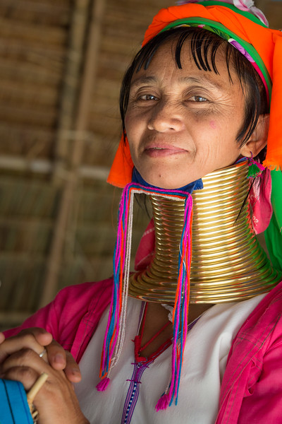 The Padaung subgroup of the Karen tribe is based mainly in Burma (Myanmar), but some, like this woman, have emigrated to northern Thailand. Within the Padaung, women adorn themselves with neck coils. The practice starts at age 5 or so, with a coil that has a few turns. As a girl matures to adulthood, the original coil is replaced with successively longer ones with additional turns.