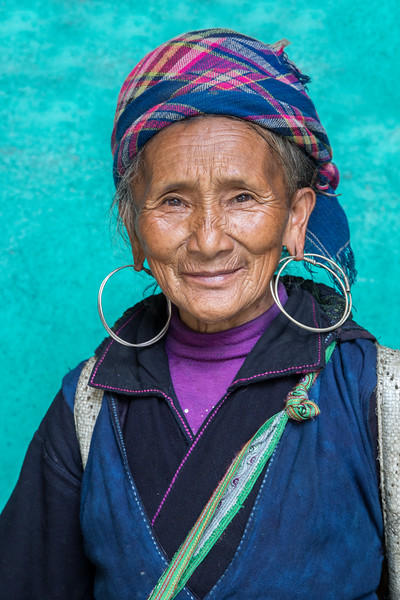The northern mountains of Vietnam are home to numerous minority tribes, many of which have distinctive dress traditions, particularly for women. This woman is part of the Black Hmong tribe.