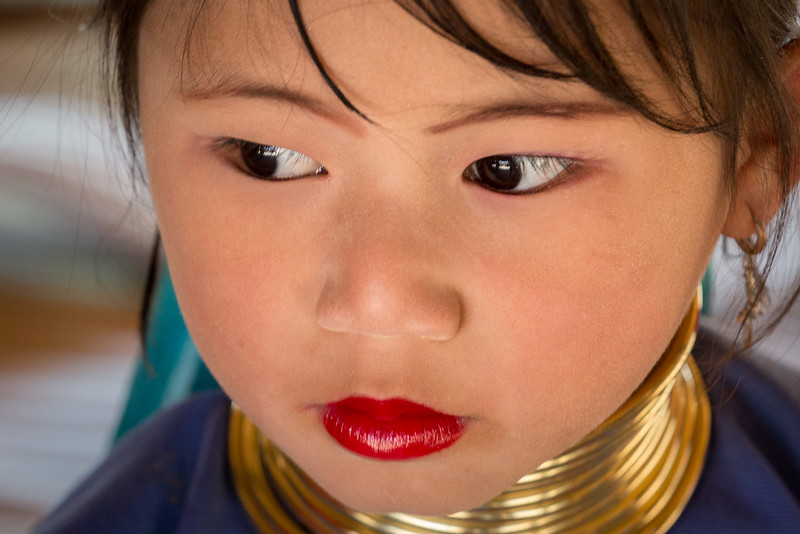A young Padaung Karen girl in northern Thailand, already started with the distinctive brass neck coil.