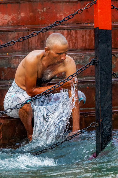 Here in the Haridwar ghats (or bathing steps), the Ganga channel is especially narrow and the current particularly swift. A metal fence aims to protect bathers from being swept away.
