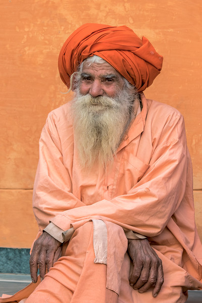 A sadhu waits patiently for a free dinner outside Geeta Ashram.