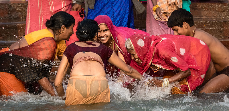 The Hindu traditions behind the Kumbh Mela include gods churning an ocean of milk in their quest for the nectar of immortality. This group of pilgrims joyfully churns the Ganga at the ghats of Haridwar.