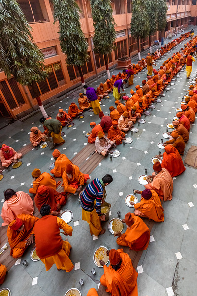 There are hundreds of ashrams in the holy city of Haridwar. This one, Geeta Ashram, provides a free dinner every evening to local sadhus and their female counterparts, sadhvis. They wait in long lines on the courtyard floor get assembly line service from ashram volunteers.