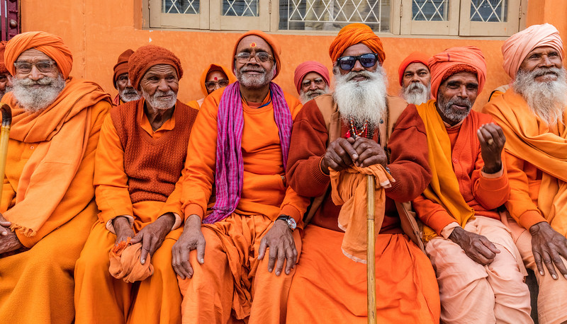 A jovial group of sadhus in the Geeta Ashram dinner line during Kumbh Mela.