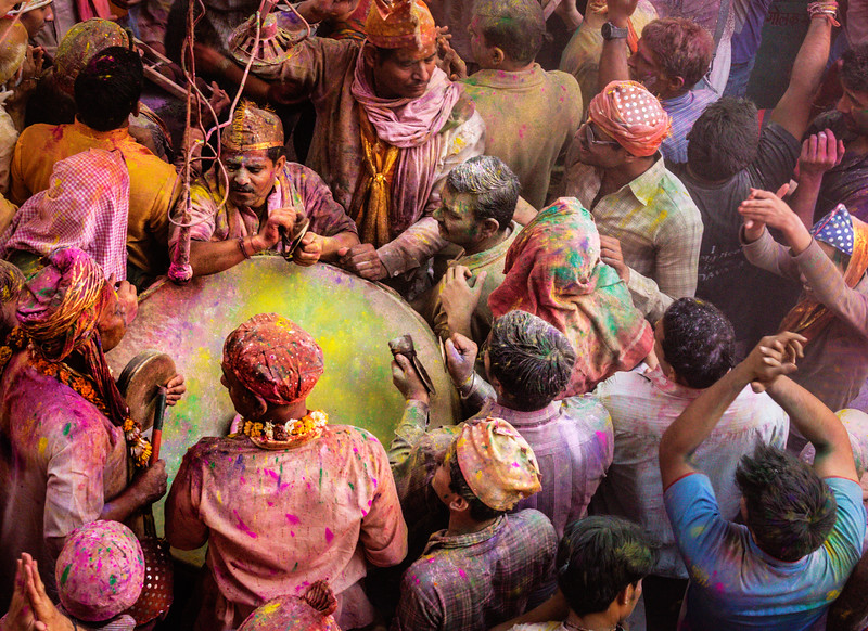 In this temple scene, Holi has a musical emphasis. Musicians are clustered around a large drum.