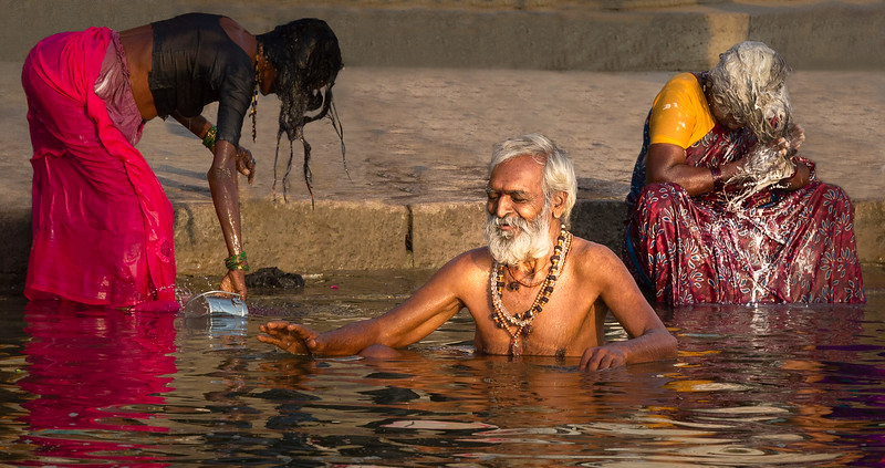 Varanasi, India.  The Ganga River is holy water for Hindus, and bathing in the river is a sacred experience. The river also meets the more ordinary daily needs of tens of millions of Indians, including these. Special Hindu extended festivals, such as Kumbh Mela, can make a Ganga pilgrimage even more spiritually compelling and draw sadhus and other celebrants by the millions.