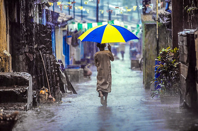 Boy with Umbrella, Colombo, Sri Lanka 1987
