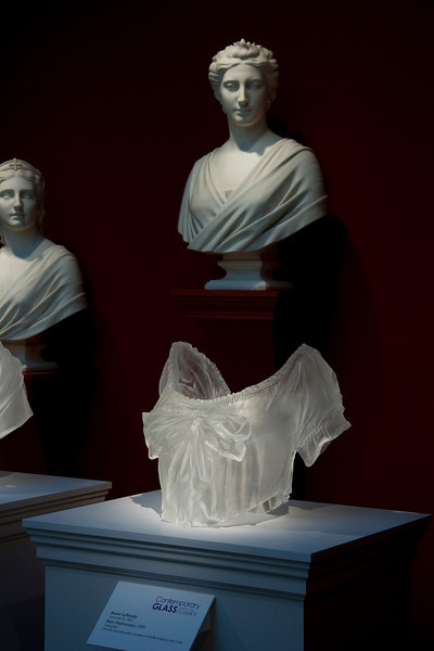 Contemporary sculpture of cast glass bust with neoclassical marble busts at the Chrysler Museum