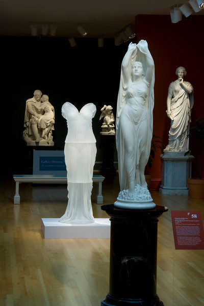 Contemporary sculpture of glass dress installed with marble neoclassical artworks at the Chrysler Museum
