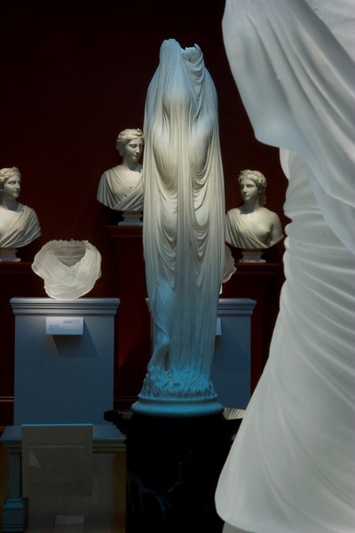 Detail of two Undine sculptures in glass and marble at the Chrysler Museum