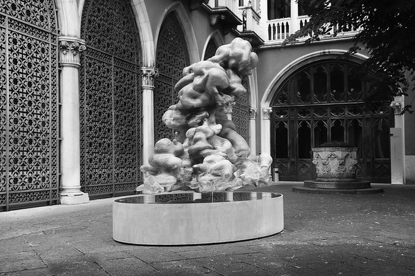 Monumental sculpture of a cumulus cloud in marble by Karen LaMonte based on work with climatologists, exhibited in Venice during the La Biennale di Venezia.