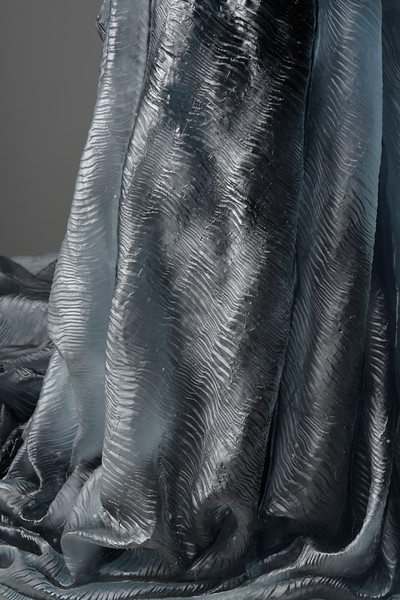 Detail of fabric on LaMonte's artwork of a glass dress without a body — a complex investigation of the female nude, culture and identity