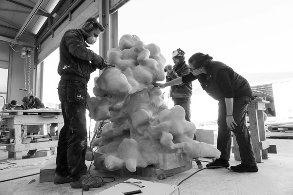 Karen LaMonte working on monumental marble cloud sculpture.