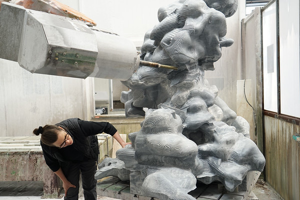 Using a giant robot to carve the monumental marble sculpture allowed the artist Karen LaMonte to preserve a precise weight relationship with the actual cloud