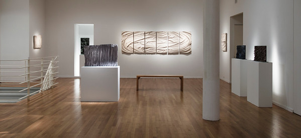 Exhibition of Karen LaMonte's abstract drapery sculptures – bas-reliefs in glass and ceramic.