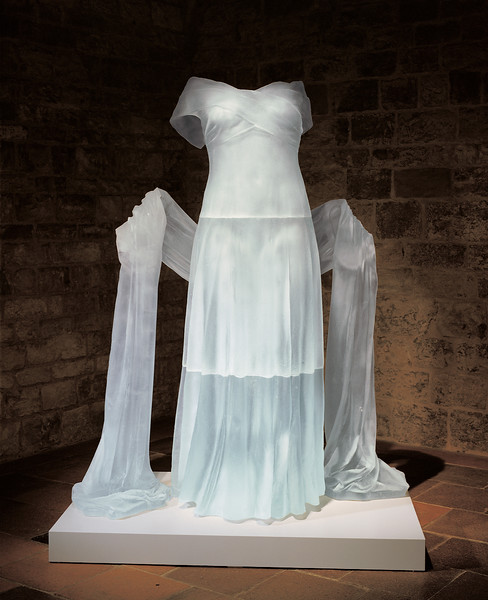 Transhistorical installation of contemporary artwork of a dress installed in the Romanesque basement of the Czech Museum of Fine Art