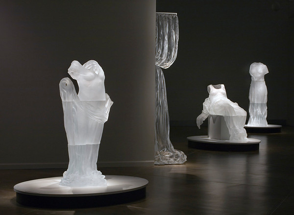 Life-size dress sculptures exhibited at the Museum of Glass in Absence Adorned by Karen LaMonte