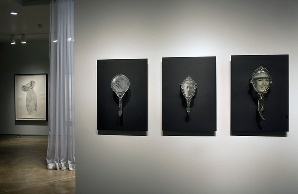 Absence Adorned exhibition with mirror sculptures and  dress print