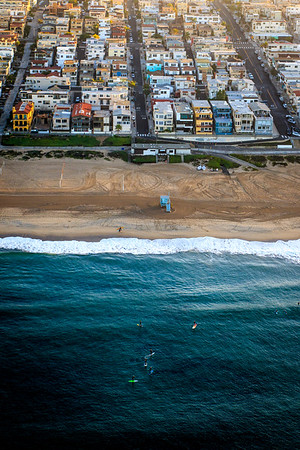 Aerial image of surfers and Manhattan Beach, CA