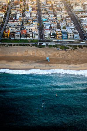 Aerial image of surfers and Manhattan Beach, CA