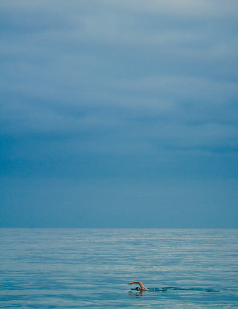 A tranquil swimmer alone in the Pacific Ocean