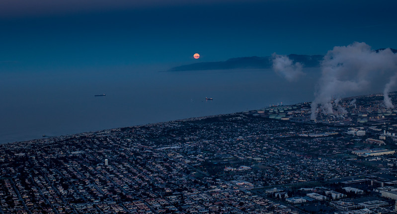 The moon sets over Malibu and the South Bay