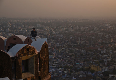 On the parapet of Nahargarh Fort at sunset, that really is a vertical drop.  I watched the young man clamber up and waited for him to stop talking to his friend and look outwards, but he never did (quite understandably!