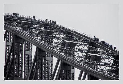 The inexplicable desire to walk over Sydney Harbour Bridge, as the clouds darken for a beckoning rain storm.