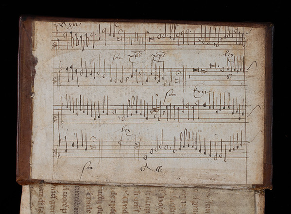 """Manuscript fragment probably produced in the seventeenth century and used to cover the inside boards of this sixteenth-century printed volume. It shows one part from a section of the Kyrie in a Latin mass setting. <br><br> <b>Author:</b> John Jewel<br> <b>Title:</b><i> A viewe of a seditious bul sent into Englande </i> (London, 1522)<br> <b>Shelfmark:</b>   <a href=""""http://idiscover.lib.cam.ac.uk/permalink/f/1nnjft8/44CAM_ALMA21397884920003606""""> M.18.13(1)</a>"""