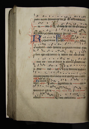 """Decorated initial C with human figure incorporated which marks the beginning of the Communion for Sunday within the Octave of Corpus Christi (also known as the Second Sunday after Pentecost): 'Cantabo domino qui bona tribuit mihi et psallam nomini domini altissimi'.<br><br>  <b>Title:</b> <i>Gradual for the use of Sarum </i> (15th century) <br> <b>Shelfmark:</b> <a href=""""https://cudl.lib.cam.ac.uk/view/MS-QUEENS-00028/1""""> Queens' College MS 28</a>"""