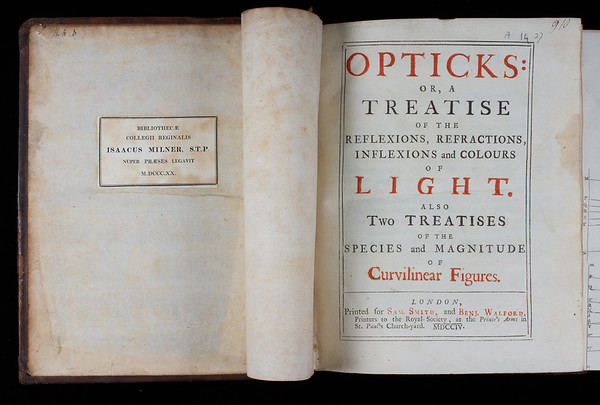 """Book label acknowledging the bequest of this book by Isaac Milner in 1820 following his death. <br><br> <b>Author:</b> Isaac Newton <br> <b>Title:</b><i> Opticks or, A treatise of the reflexions, refractions, inflexions and colours of light </i>(London, 1704) <br> <b>Shelfmark:</b> <a href=""""https://idiscover.lib.cam.ac.uk/permalink/f/1nnjft8/44CAM_ALMA21606041340003606""""> A.14.27</a> <br> <b>Provenance: </b> Formerly owned by Isaac Milner (1750–1820)"""