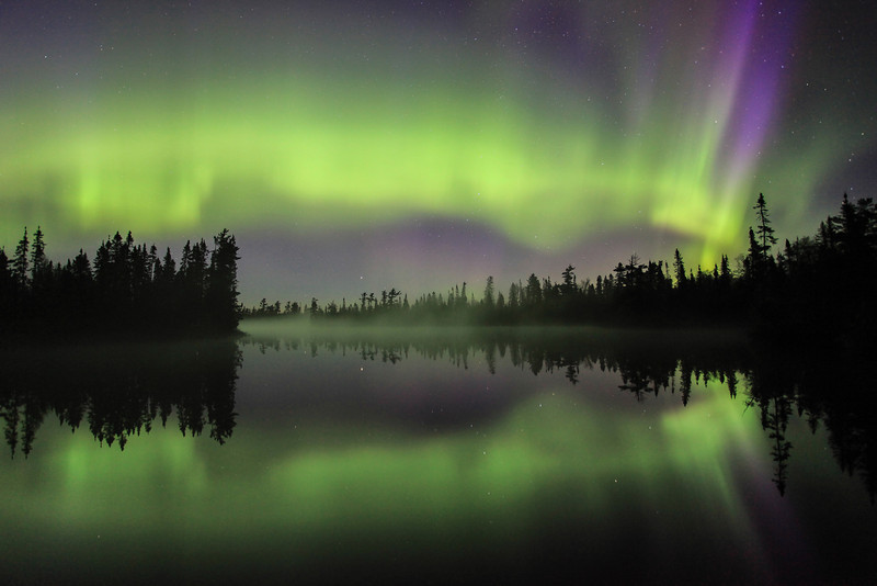 """FRIDAY, JUNE 7, 2013<br /> <br /> AURORA 4166<br /> <br /> """"Celestial Storm over Devil Fish Lake""""<br /> <br /> I could not believe my eyes last night as I stood on the shores of Devilfish Lake and watched this incredible aurora filling the sky overhead and reflecting in the ultra-calm waters of the lake below. This photo was taken about ten minutes after the """"Solar Shock Wave"""" photo was made. As I watched this unbelievable light display in the sky, the haunting call of a pair of loons echoed from across the lake. I couldn't think of any music more perfect than the call of loons while watching the Aurora Borealis. Heaven in the north woods for sure!<br /> <br /> Camera: Canon EOS 5D Mark II<br /> Lens: Canon EF 17-40mm<br /> Focal length: 17mm<br /> Shutter speed: 25 seconds<br /> Aperture: f4.0<br /> ISO: 1600"""