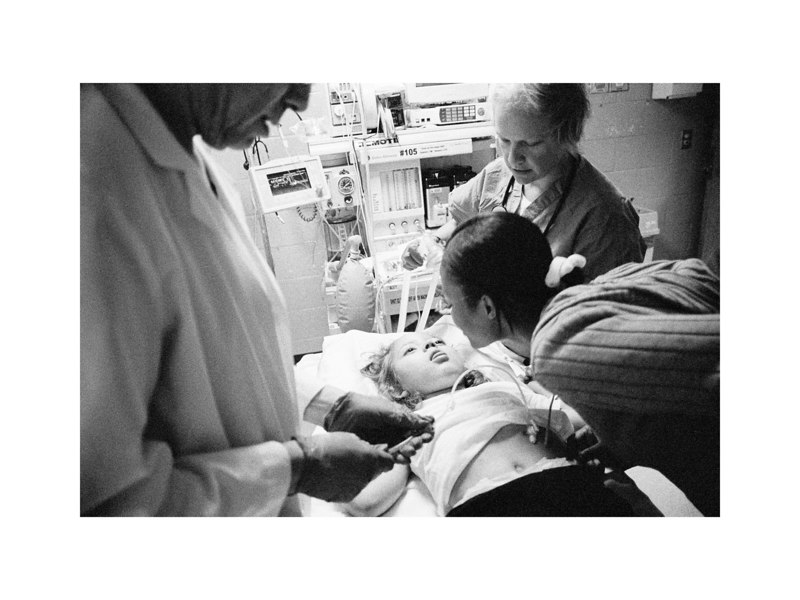 Jeanette gives little Max one last kiss before he goes into the MRI as the Hopkins staff prepares him for the scan.