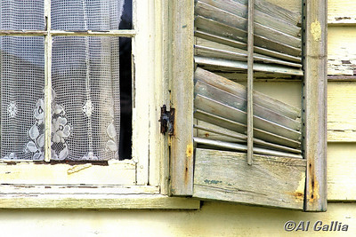 "2ND PLACE AWARD. ©Al Gallia; ""Aging Elegance""; Old lace curtain in weathered window of historic Acadian home in Vermilionville Cajun/Creole Heritage Park, Lafayette, Louisiana."