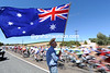 AN AMERICAN FAN WITH AN AUSTRALIAN FLAG ON STAGE ONE OF THE TOUR DOWN UNDER