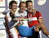 PAOLO BETTINI CELEBRATES ON THE PODIUM WITH ERIK ZABEL AND ALEJANDRO VALVERDE AFTER WINNING THE ELITE MENS WORLD CHAMPIONSHIP ROAD RACE