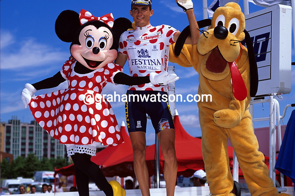 Tour Stars - Minnie Mouse and Pluto make a big fuss of Richard Virenque at Eurodisney in 1997