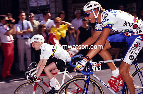 Wilfried Peeters pushes a cheeky young fan dressed in the World Champion's colours, during the 1991 Tour de France.