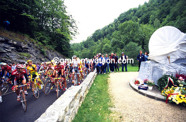 A Somber Halt - Italian cyclists stop at the Fabio Casartelli memorial during the 1996 Tour de France