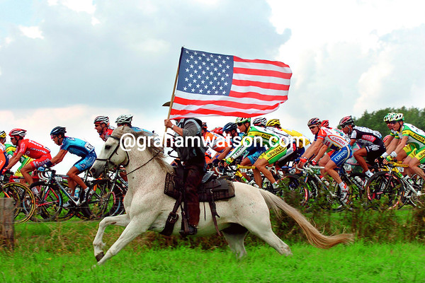 A Fan's Salute - A Belgian horseman gallops alongside the peloton in 2004<br /> <br /> TREASURED IMAGE