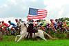 A Fan's Salute - A Belgian horseman gallops alongside the peloton in 2004<br /> <br /> TREASURED IMAGE