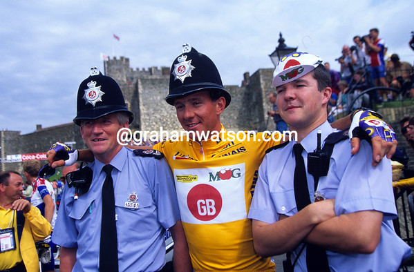 """""""Hello, Hello"""" - Johan Museeuw poses with two British 'bobbies' at Dover in 1996."""