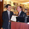 "Congressman Ed Royce presents a ""Certificate of Congressional Recognition"" to Kevin Lee.<br /> Chapman University"