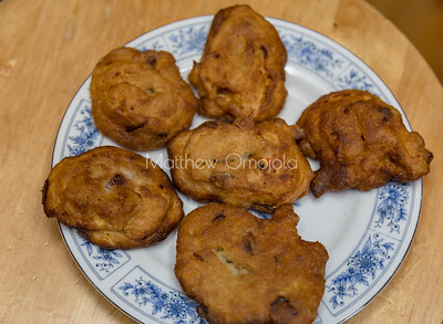 Akara. It is made from blended peeled black eyed beans along with appropriate condiments /spices and fried in oil, usually palm oil but other vegetable oils are acceptable..