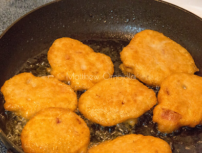 Akara in the process of being fried. It is made from blended peeled black eyed beans along with appropriate condiments /spices and fried in oil, usually palm oil.
