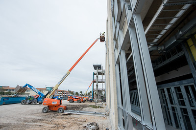Crews work on the west side of the Tidal Hall building.