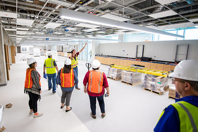 Quality Assurance Manager of the Tidal Hall construction site, Lawrence Gaertner, gives a tour of the building's progress to the TAMU-CC Marketing and Communications department.