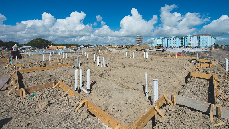 The Momentum Village Phase-2 construction site continues as the plumbing and foundation is applied to the new expansion on September 15, 2016.