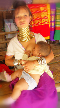 Kayan girl feeding her Kid