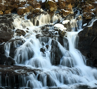 One of a series of falls at Hraunfossar, western Iceland